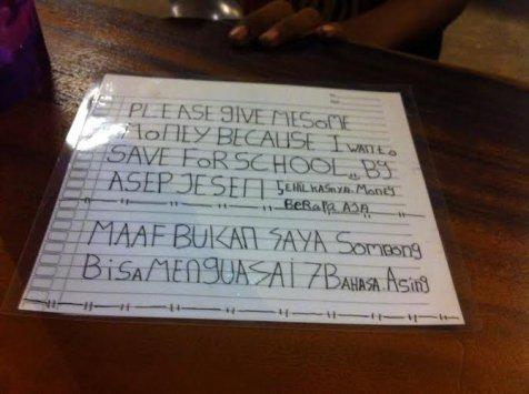 Kertas yang ditulis Asep saat mengamen (Merdeka)